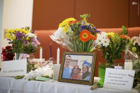 A makeshift memorial for Deah Shaddy Barakat, his wife Yusor Mohammad and Yusor's sister Razan Mohammad Abu-Salha, who were killed by a gunman, is pictured inside of the University of North Carolina School of Dentistry, in Chapel Hill