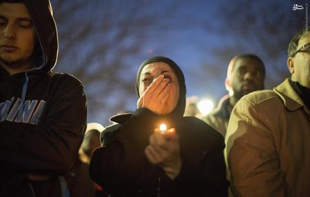 A woman cries as a video is played during a vigil on the campus of the University of North Carolina, for the three young Muslims who were killed in Chapel Hill